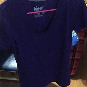 Dark purple short sleeve Nike DriFit V-neck shirt